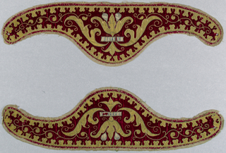 Two apparels (separate collars worn by a priest over the neck of a vestment). Red velvet with applied design in gold cloth outlined with couched gold thread, and white silk with subtle decoration in blue thread. Central design of conventionalized flower with wide leaves ending in long tendrils of gold thread. Flower crossed by a band of white silk with perpendicular blue embroidered lines, and two leaves in white silk couched in blue thread. Backed with a coarse natural linen. Apparels are incomplete and would have been lined with linen or silk and fastened with cords and tassels which are missing.