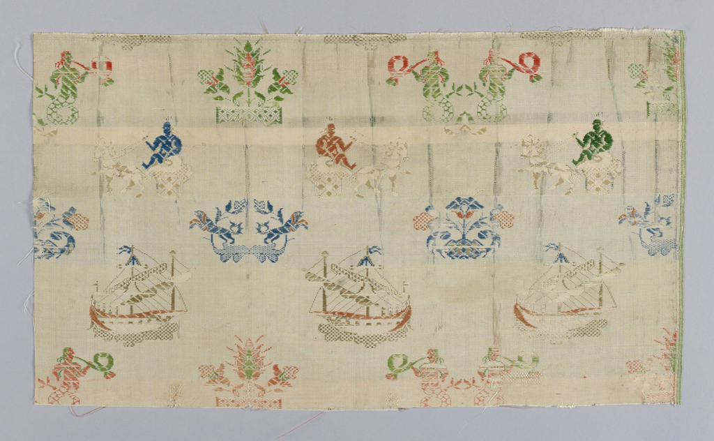 Off-white silk brocaded in multicolored silks in a fan-shaped pattern of detached elements in a horizontal arrangement. Threes rows in a staggered repeat have a tree and flower motif that alternates with paired mermen blowing horns. The next row has men in chariots. Below are addorsed leaping dogs that aternate with a floral spray. Row below has a square-rigged vessel.