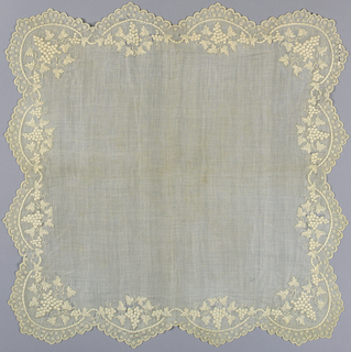 Large square handkerchief of sheer white linen embroidered around border with grapevine design. Scalloped edges.