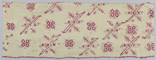 Small piece of linen, embroidered in red silk, showing floral and geometric shapes.