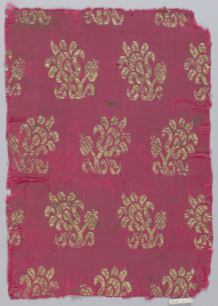 Floral motif facing in alternate rows on red ground.
