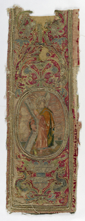Fragment of an embroidered orphrey on red satin. Medallion in the center shows a saint carrying the cross.
