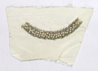 Sample of white silk with a curved band of beaded embroidery, with gold rick-rack, clear glass beads, and faux pearls.