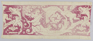Band fragment showing mermaids, cupids and fantastic heads on a floral vine. In red silk on linen.