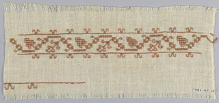 Linen cloth embroidered in red thread in the design of an angular stem with leaves and grapes.