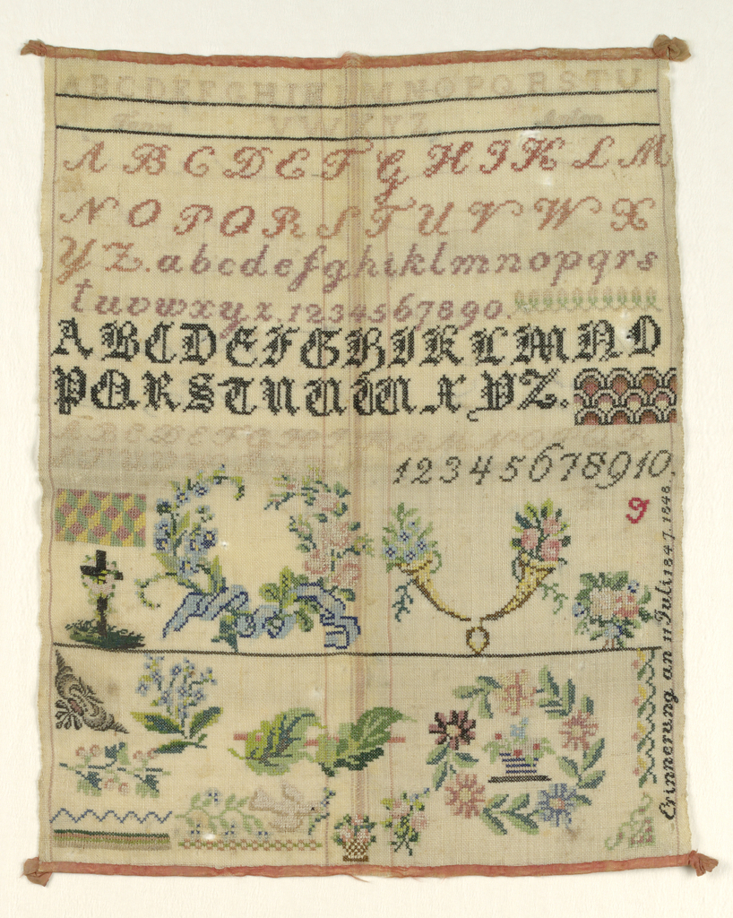 Alphabets at top, then wreaths and flowers.