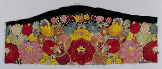 Fragment of a black velvet apron embroidered in multi-colored flowers.