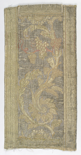 Pattern of flowers and grapes within outer guard borders. heavily mended.