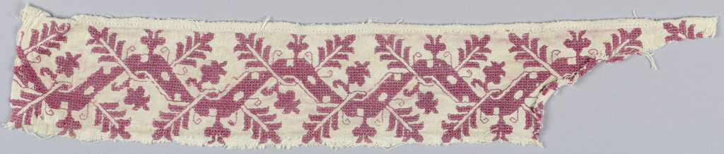 Band fragment showing a geometric flowering vine in red silk on linen.