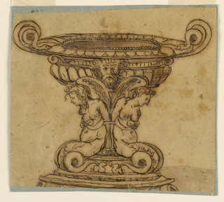 Horizontal rectangle. Two winged mermaids are seated upon a round base and are attached to the shaft. The body of the bowl is bossed and shows a satyr mask in the center. Mouldings are on top. Two snakes form the handles. The supports are not entirely shown.