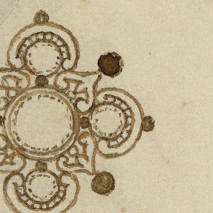Two designs, one above the other. At top, the frame of a circular diamond has outside arches with alternatively a fleur-de-lys and a brilliant upon points. Below, five diamonds forming a cross, with inverted chalices with pearls outside, in the wedges.