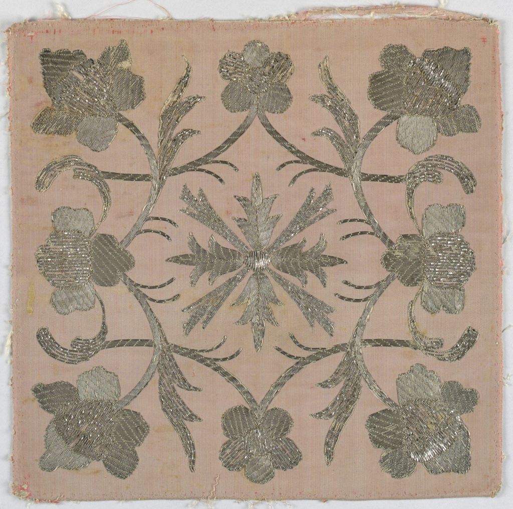Embroidery is in the design of an ornament formed by eight floral sprays placed around a cross with rays set between the arms.