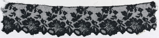 Black lace border with scalloped edge formed by flowers with a curving stem with flowers and leaves rising from each border flower.