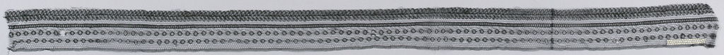 Black cotton lace edging; horizontal repeat of circular and oval motifs.