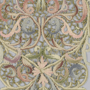 Polychrome silk set of collar, cuffs and vestee worked in a scrolling leaf pattern and joined by brides.