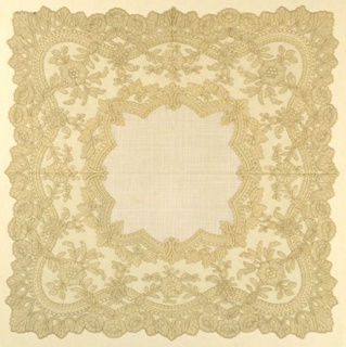 Handkerchief of linen with wide border of late Valenciennes lace in design of curving band with floral ornaments.
