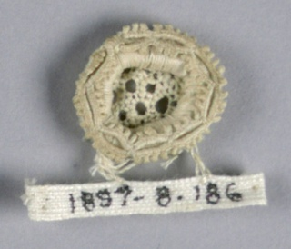 Fragment in a rosette pattern with an openwork center.