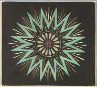 Magic lantern slide, optical toy. On black field, sixteen-pointed star outlined in green paper, with pierced rays clustered in groups of three, radiating from central motif of red whorls and white patera, surrounded by circle of pierced circular openings.
