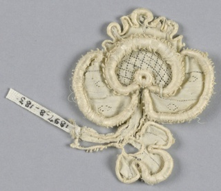 Fragment in a pattern of a trefoil blossom with a stem and trefoil bud. Center in a diamond diaper pattern. One petal scalloped.