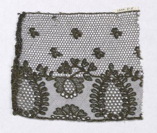 Black silk thread hand run on net. Border design of a cone pattern with smaller blossoms scattered over ground.