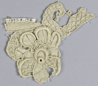 Fragment with a floral design and a portion of the leaf and stem. Diamond diaper design in parts.