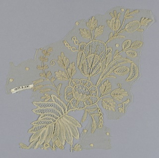 Fragment of Brussels-style lace showing a large-scale design of a floral group, including a rose and lily.