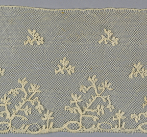 Border of Lille-style lace with stylized floral sprays in a repeat pattern.