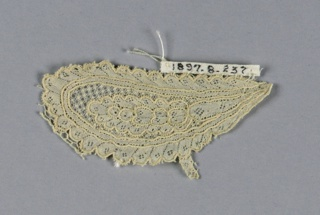 Fragment of Argentan lace with a leaf design.