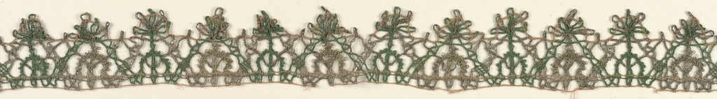 Fragment of lace with green and red silk and silver gilt thread.