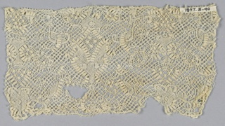 "Binche-style fragment with delicate floral design with many rectangular dots forming geometric ornaments. ""Cinq trous"" ground."