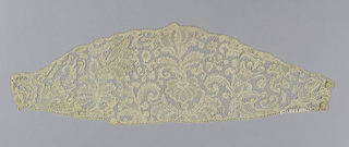 Cuffs of Point d'Angleterre in a pattern of conventionalized flowers and leaves with ornamental fillings forming a cuff that is wider at center than at closing.