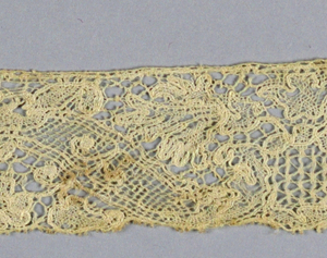 Lille-style fragments with a pattern of floral forms separated by scrolls.
