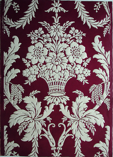 Design includes motifs of cartouche, basket and floral. Printed in white on burgundy ground.