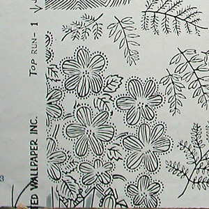 Freely executed black line drawings of baskets of flowers and a basket of pears. The baskets are touched in places with silver. Leaves and flowers and branches scattered at random around the major motifs. Half of a vertical column of baskets appears at each margin where the match occurs, on white ground.