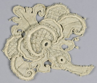 Fragment with a large elaborate flower and picot edges. Several petals and center in a diamond diaper design.