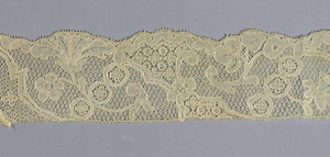 Mechlin-style border with asymmetrically placed floral garlands.