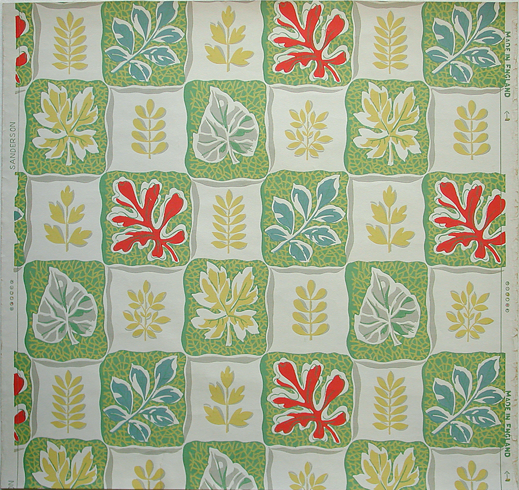 Irregular-edged vertical rectangles, green and white, alternating in checkerboard pattern. Different types of yellow leaves adorn the white rectangles, while the green rectangles have larger leaves of red, gray, blue and yellow. Yellow veining covers the green ground.