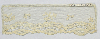 Cuffs with a design of floral sprays and borders applied to net.