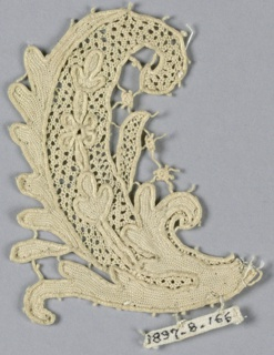 Fragment of raised lace with a design of an ornamental scrolling leaf with openwork center and superimposed rosette and leaves.