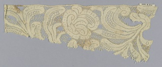 Fragment of discontinuous bobbin lace.