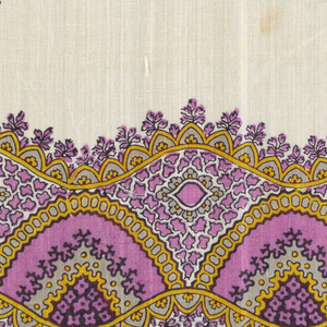Quarter of a printed scarf with wavy lace-like patterned border and field with widely spaced floral medallions in magenta, yellow, grey, and black.