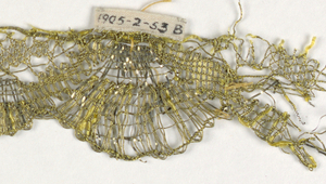 Gold lace border with one scalloped edge formed by fan-shaped pieces extending beyond semi-circles. In yellow silk and metallic thread.
