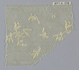 Fragment of Lille-type lace showing small flowering branches and floral spray.