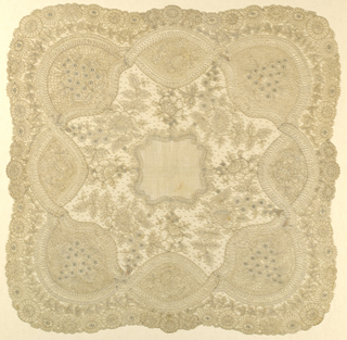 Handkerchief with center of linen and wide bobbin lace border of Brussels lace. Pattern of floral sprays edged by festoons and open flowers.