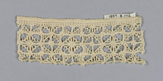 Fragment with rows of squares with diamond shapes in the center.