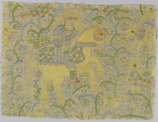 Mughal-style fragments of embroidered silk on linen. Design shows man with dagger on horseback surrounded by plants and animals.