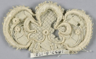 Fragment with an elaborate floral motif of tiny, superimposed rosettes. Central portion has a fine diamond diaper design. Picot edge.
