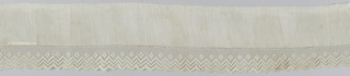Design of scalloped border with bow knots and flowers on diamond mesh.