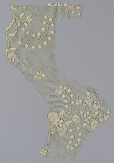 Fragment showing large delicate ribbon-tied floral sprays. Very irregular in shape.