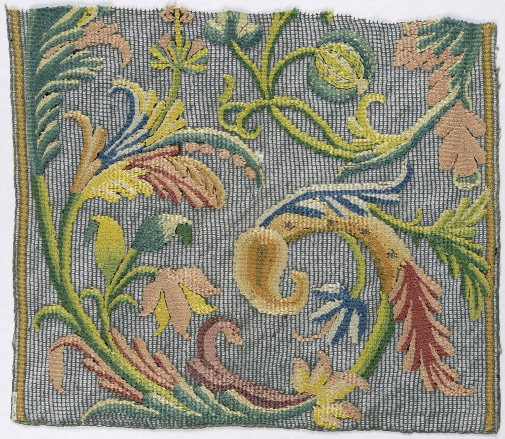 Portion of a large scale polychrome floral design on green knotted net.